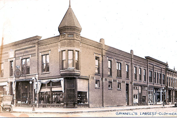 storefront on a corner with a turret above