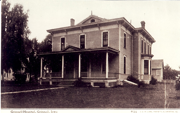 Large two-and-a-half story building with porch