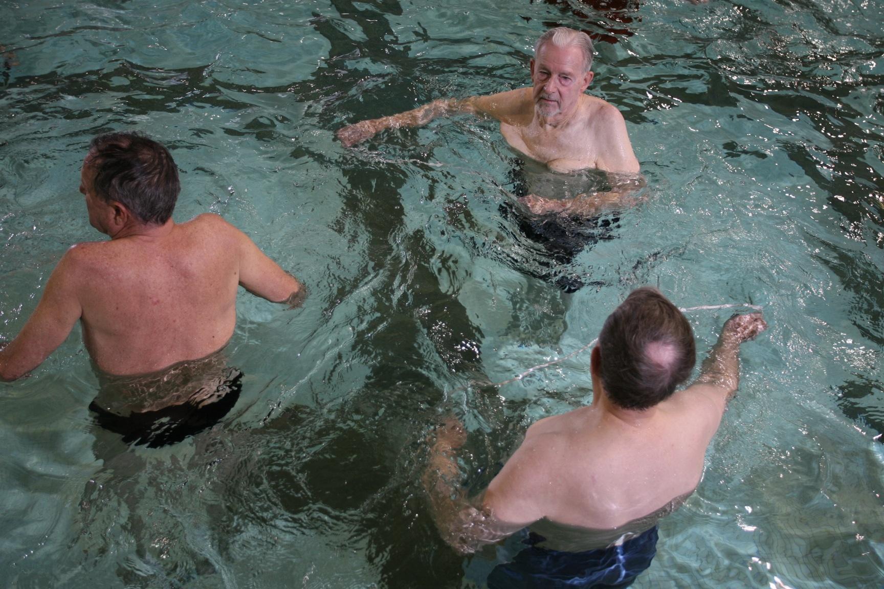 three men near each other in pool