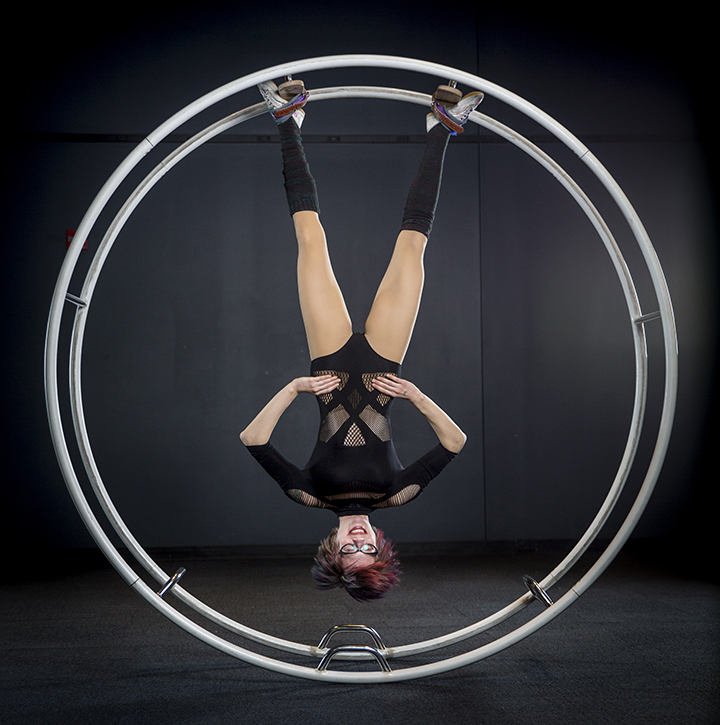 Carly Schuna '06 hangs upside down inside her German wheel