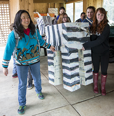 Group carries the painted zebra through the zoo