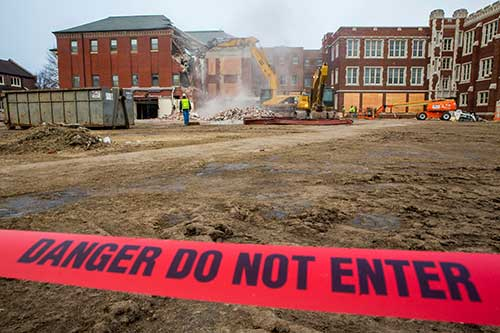'Danger - Do Not Enter' tape blocks visitors from the demolition site