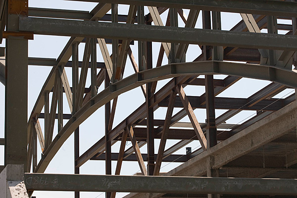 fieldhouse beams creating the outline of future roof