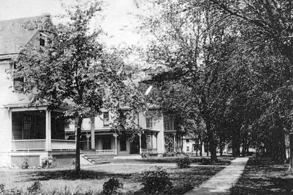 street lined with large houses and trees