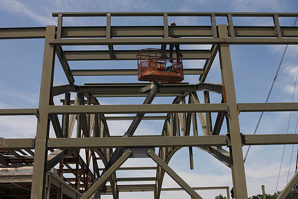 crew hangs suspended from beams