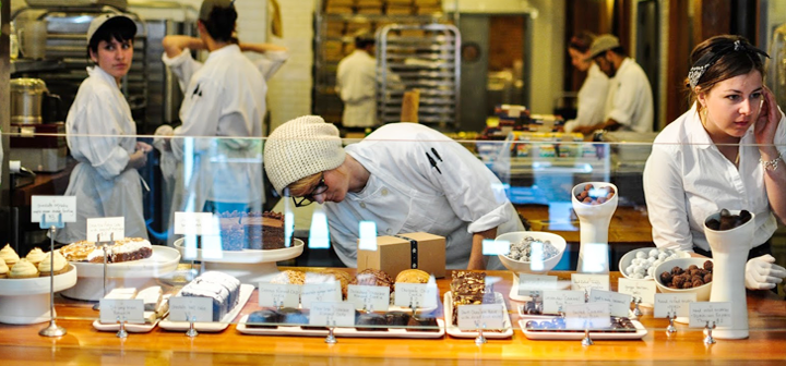 Anna Halpin-Healy '13 on far right at the counter of the chocolate factory