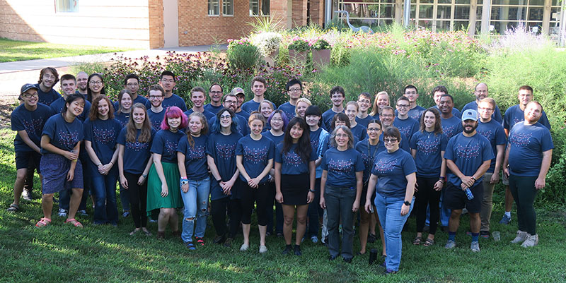 Students designed the group T-shirts seen in this photo of the chemistry summer research students, faculty, and staff.