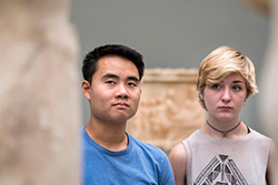 Bryce Lew and another student contemplate a sculpture at a Copenhagen museum