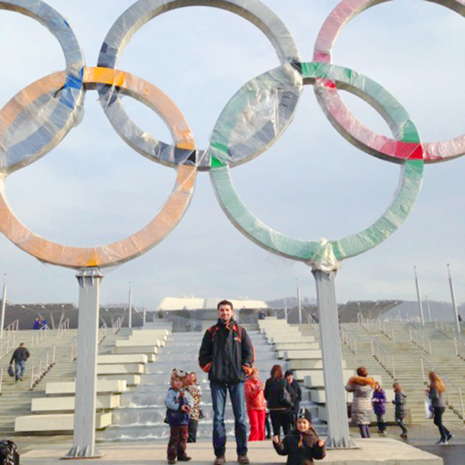 Daniel Wolfe '99 under Sochi Olympic rings