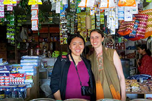 Diana Jue and Jackie Stenson in a street vendor stall in India