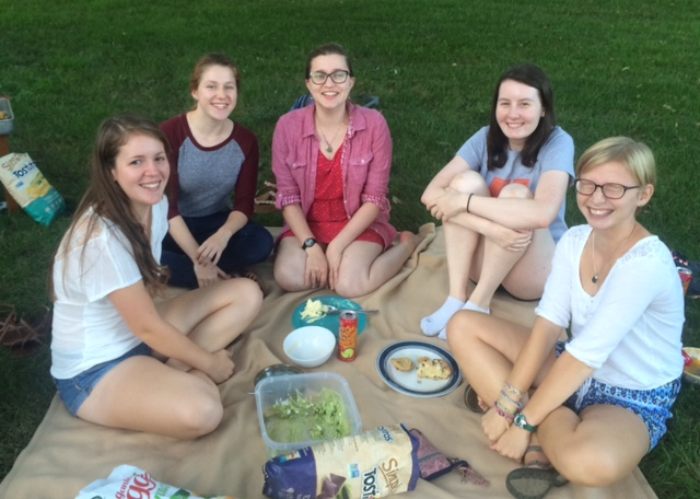 Fresh Flute picnic Grace (far left), Marie (hugging her knees), and Kirsten (far right):