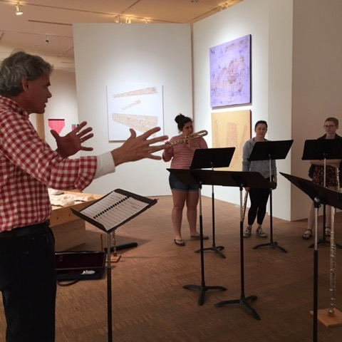 John Rommereim conducting with Fresh Flutes in Faulconer Gallery