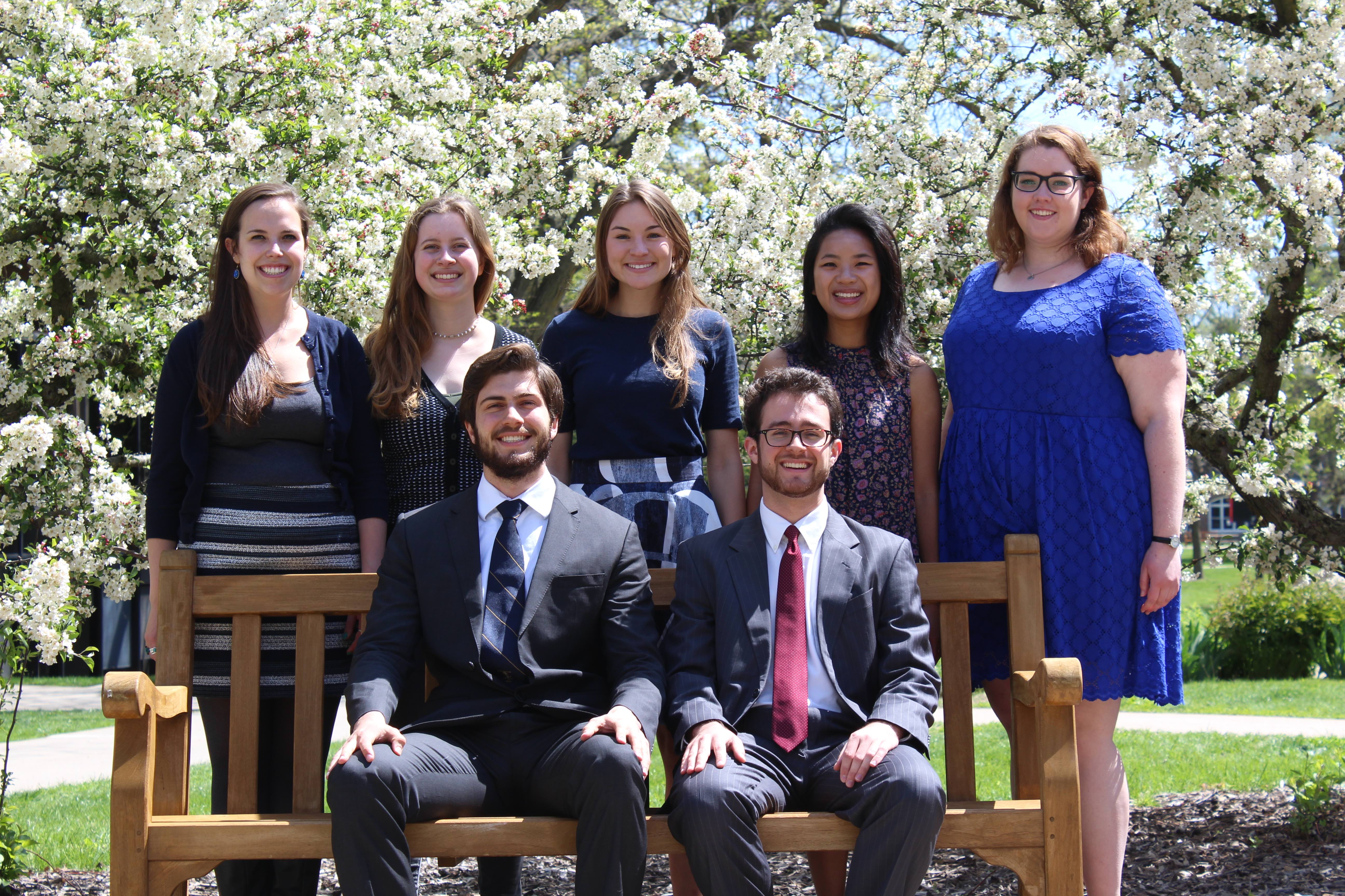 From left: Fulbright recipients recently gathered on the Grinnell Campus. Seated: Ian Stout, Kieran Connolly. Standing: Mollie Jo Blahunka, Caleigh Ryan, Samantha Fitzsimmons Schoenberger, Sophie Wright and Stella Gatzke. Not pictured: Lilianna Bagnoli.