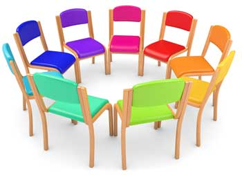 Chairs arranged in a circle, all in different bright colors