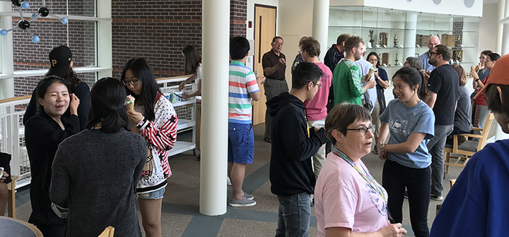 Mingling people at the chemistry ice cream social.