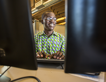 Larry Boateng Asante '17 between two monitors