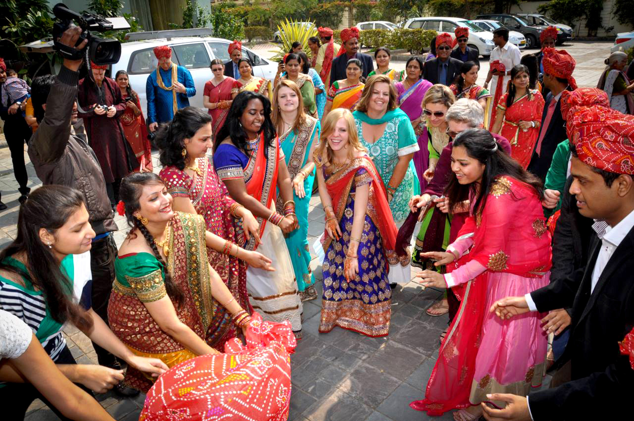 Lilliana Bagnoli in a crowd of men and women in brightly colored Indian garb