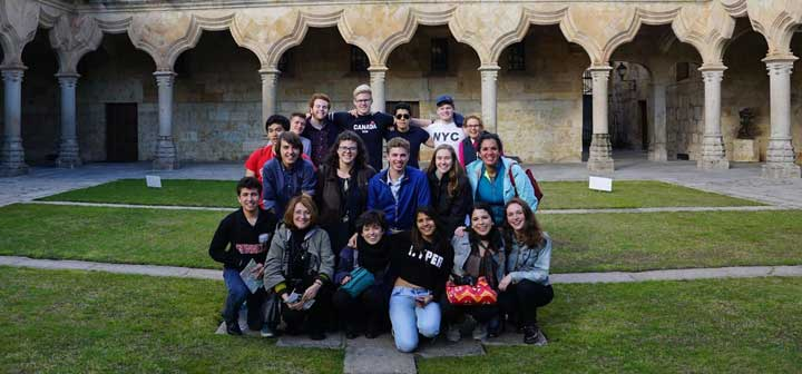 The Origin of Liberal Education tutorial group gathers in front of the University of Salamanca
