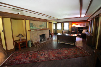 Interior of Ricker House main room including tiled mural above the fireplace