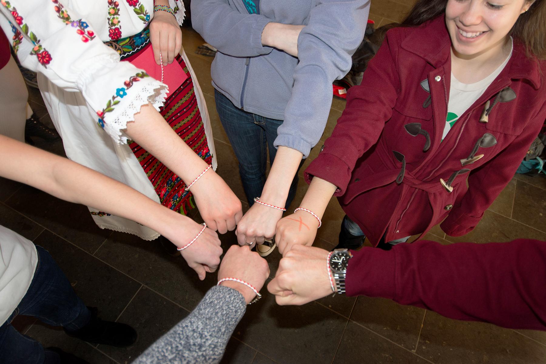 Wrists sporting the bracelets