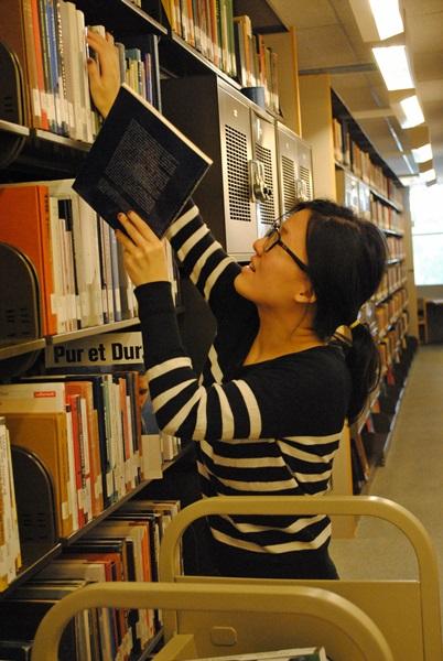 Student shelving books