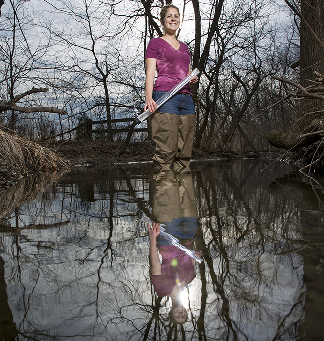 Tayler Chicoine in waders reflected in water's surface