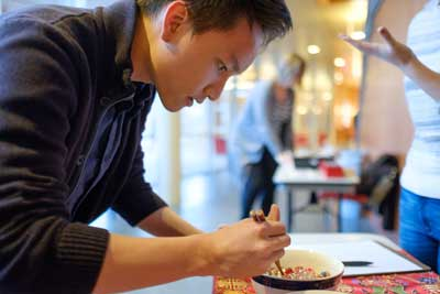 Hoang Cao '19 puts his chopstick-wielding skills to the test by competing in the timed contest to transfer the most marbles from one bowl to another.