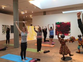 Fresh Flutes doing yoga in the Faulconer Gallery