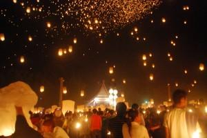 Lanterns floating in the night sky in Chaing Mai