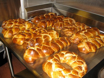Several golden-brown loaves of Challah.