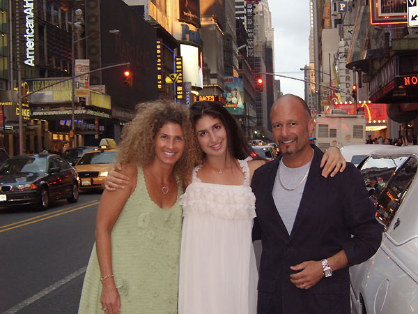 Chef Harry and family pose for the camera on a city street