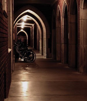 darly lit loggia with bikes