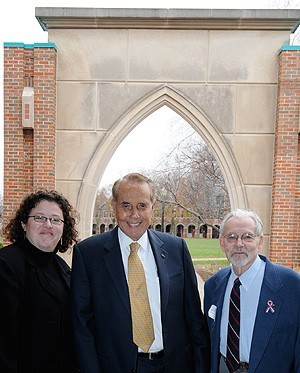 Bob Dole posing with Sarah Purcell '92 and Art Heimann.