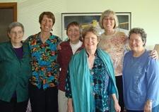 group of women smiling at camera