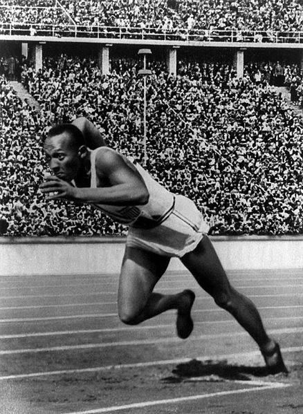 Black and white image of Jesse Owens racing