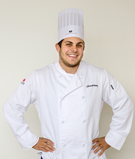 Eric Mistry '14 in chef's outfit