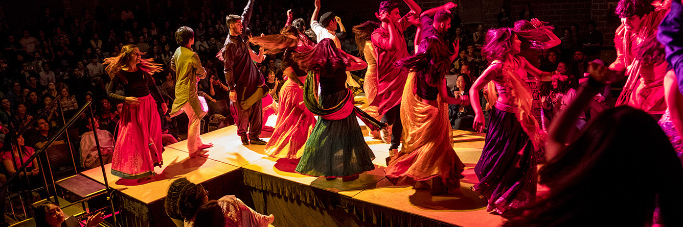 Students perform international dances in colorful costumes