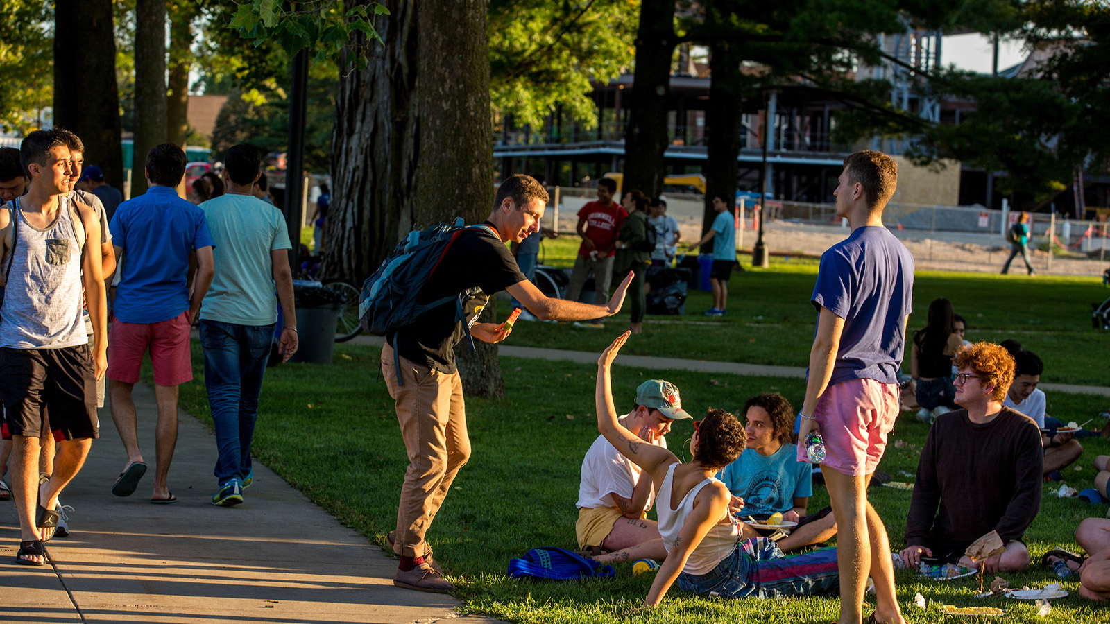 Students high-five at the all-campus picnic