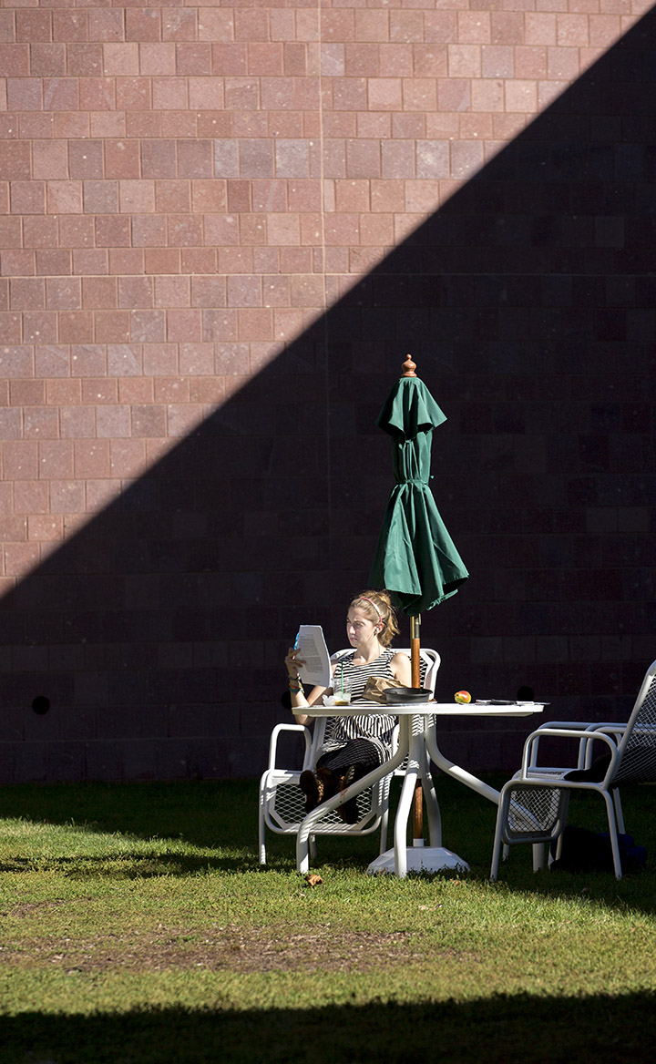 A student soaks up some sun while studying outside of the JRC.