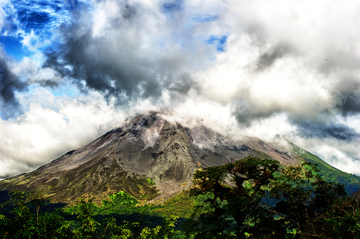 Clouds covering the top of Arenal volcanic mountain.