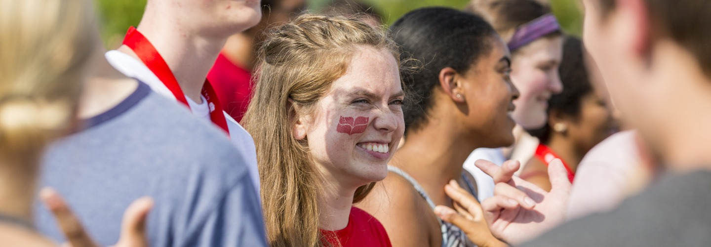 Student with college logo on cheek