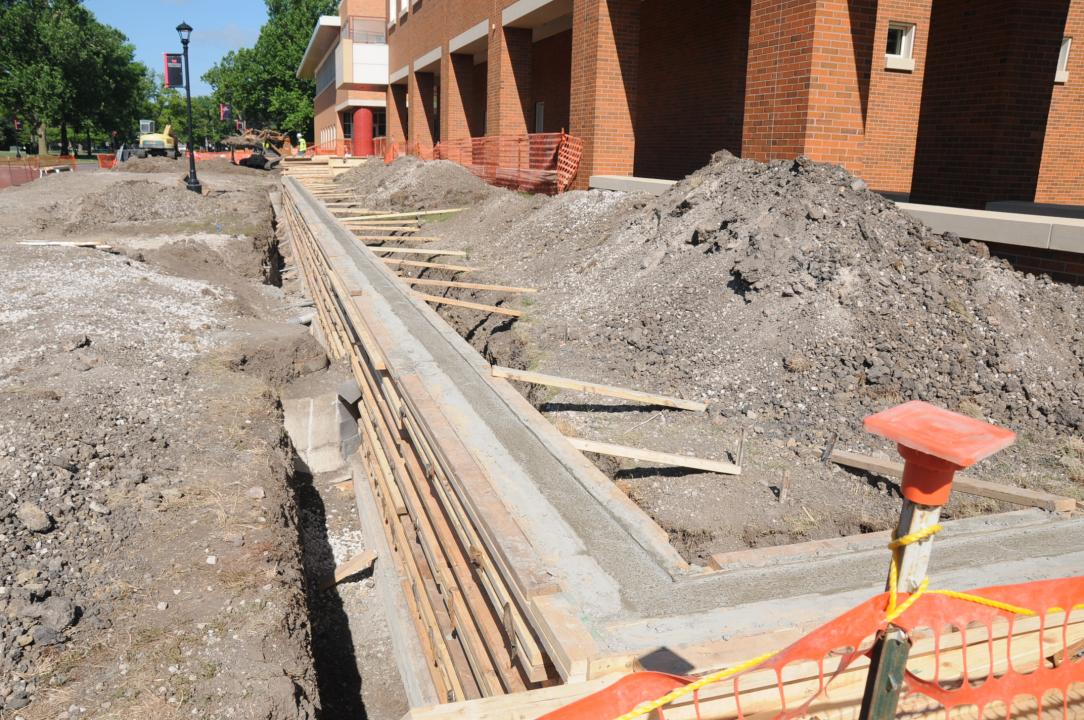 A picture of the construction of the East retaining wall South of the building