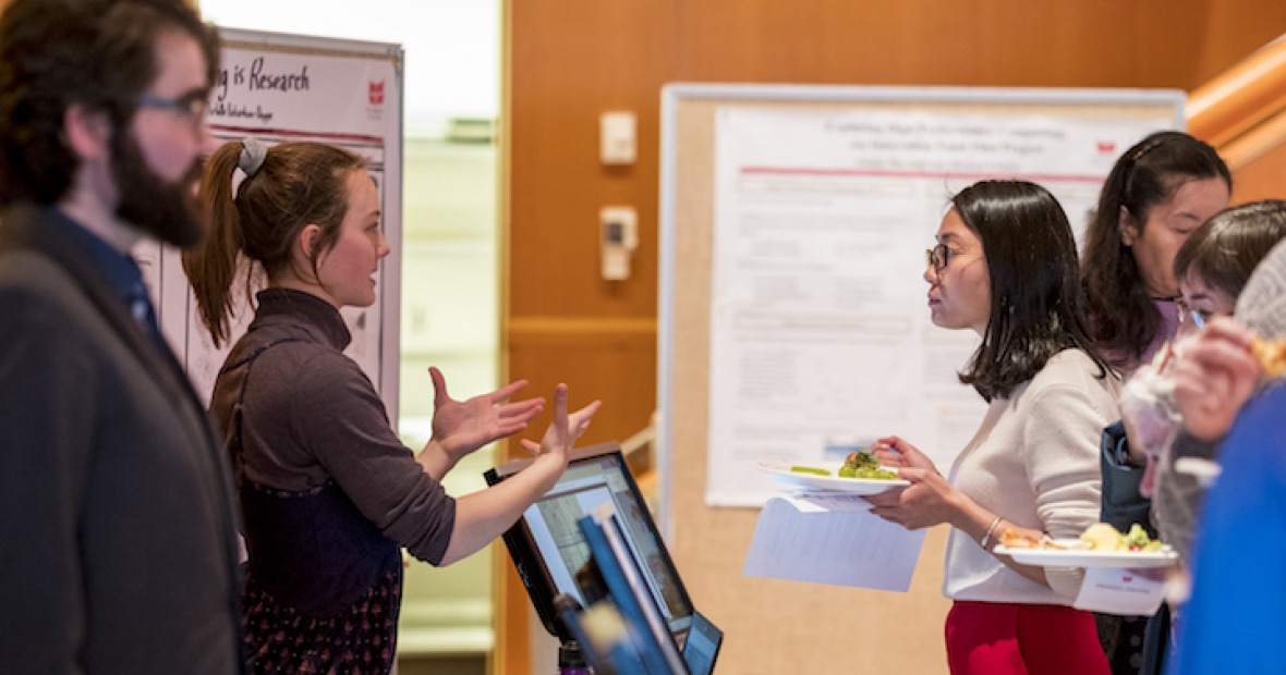 Attendees explore exhibits at the Digital Liberal Arts Teaching Fair
