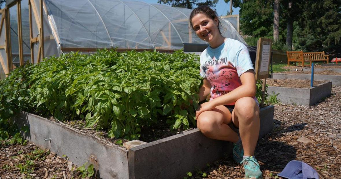 Julia Chamberland tending a raised garden