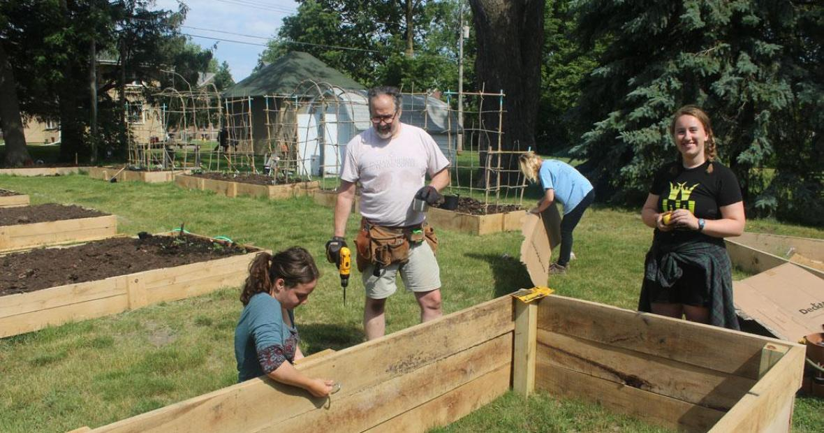 People constructing walls for raised beds