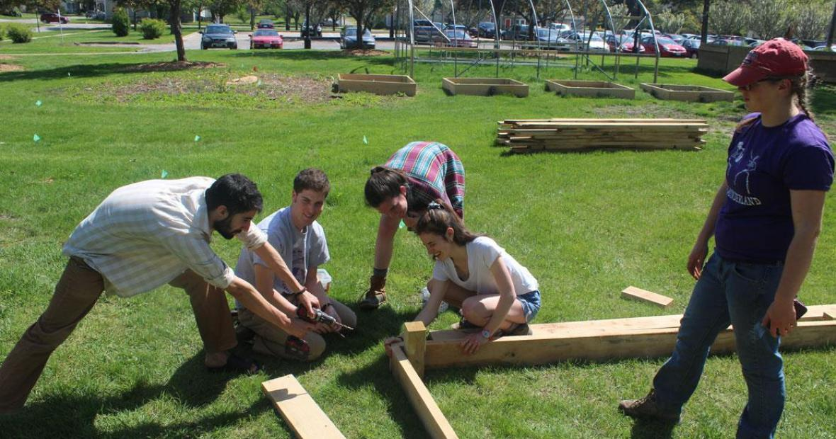 Students building raised beds at the garden, April 2017
