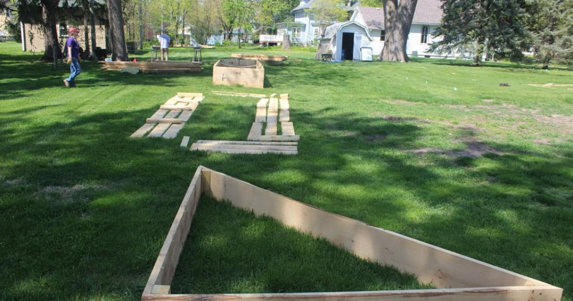 Thick white oak lumber being used to construct raised beds