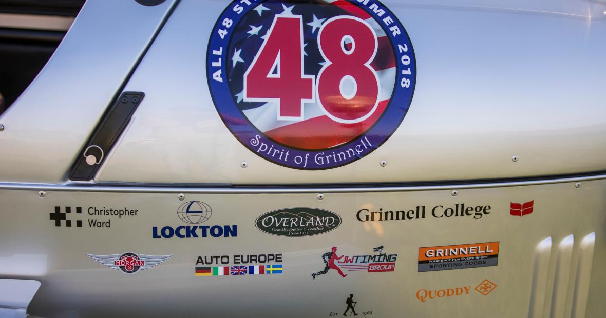 The side of Will Freeman's three-wheeler, with sponsors and logos