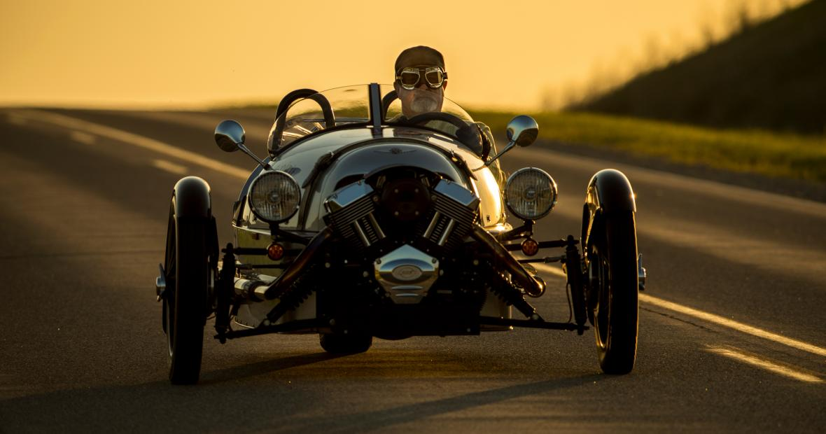 Will Freeman drives his three-wheeler on the highway