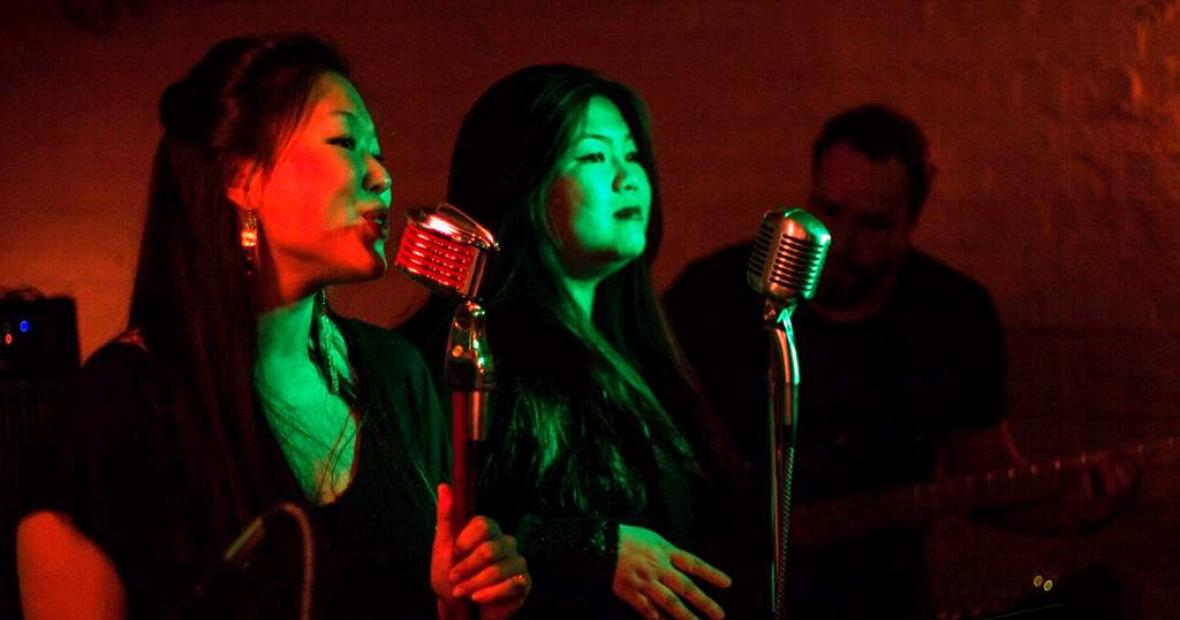 Yang and Joyce sing at a concert.